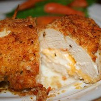 """Not your everyday chicken dish! Stuffed with Cheddar and cream cheeses, then drenched with a garlic-lemon-butter sauce, your friends and family will be begging you to make this recipe -"