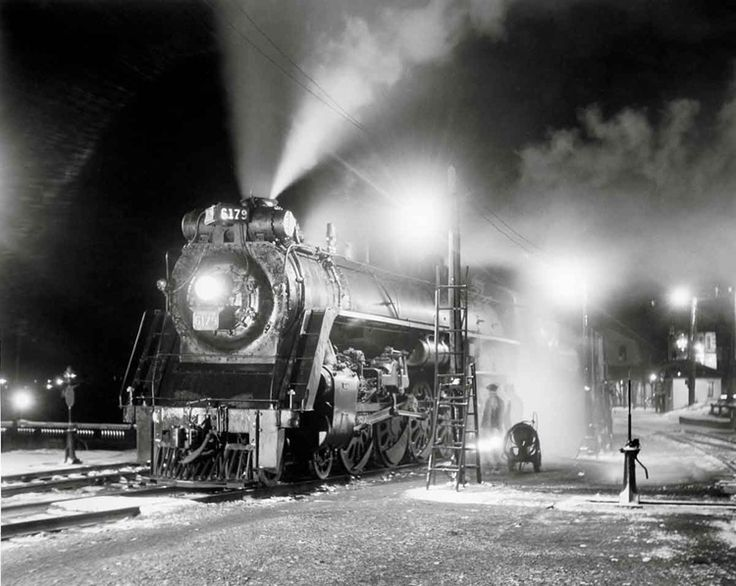 CN's Maritime Express Canadian National 4-8-4 No. 6179 is serviced at Rivière du Loup, Quebec, during a 15-minute stop with the eastbound Maritime Express in October 1953. Philip R. Hastings photo