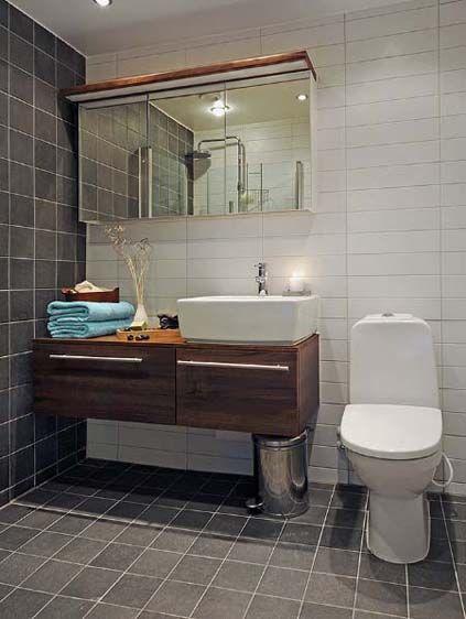 styl skandynaski, szwedzkie mieszkanie, bialo czarna lazienka, lustrzane szafki lazienkowe, proste meble lazienkowe, wnetrze mieszkania