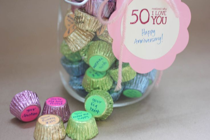 """Here is an inexpensive but meaningful gift I made for my hubby for our anniversary last month. I filled a jar with 50 pieces of his favorite candy (Reese's Peanut Butter Cups). On the bottom of each candy, I used a round """"garage sale"""" sticker and wrote on each one a reason why I love him. It sits on his desk and every time he reaches for a candy, he is reminded why I love him!"""