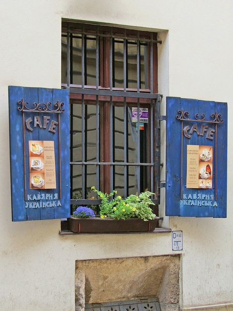 Cafe window with shutters in the Old Quarter of Krakow, Poland.