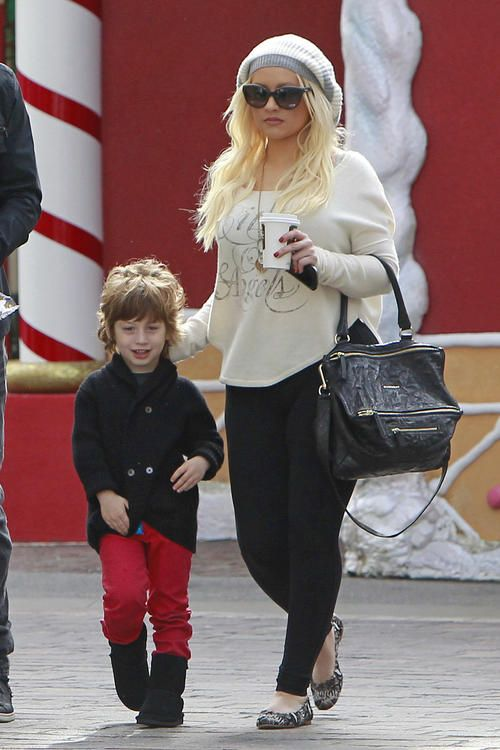 Christina Aguilera and her 4-year-old son Max were joined by her boyfriend, Matthew Rutler as they made their way to visit Santa Claus at The Grove in Los Angeles, Calif. on Thursday, December 13 Little Max  wore a pair of festive red pants for his special visit.