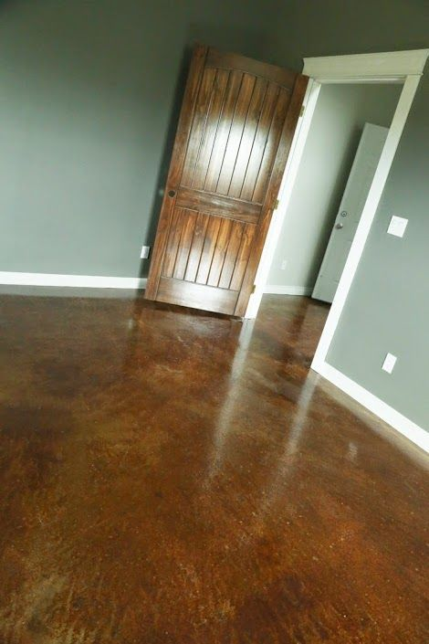DIY: How To Stain & Finish A Concrete Floor - great tutorial shows how to finish 700 sq. ft. of flooring for $300. This is a durable finish, it's a DIY project & it's inexpensive.: