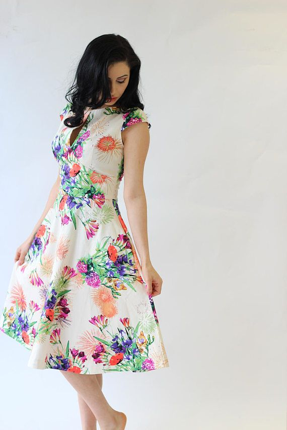 Striking cotton summer dress in a vibrant mixed floral print, with a fitted bodice, cap sleeves, concealed back zip, discreet side pockets, and full mid-length skirt, which will be expertly handmade to your precise measurements.  Made with cotton sateen (97% cotton, 3% spandex), it has a soft silky feel to it, with just the right amount of stretch for a better fitting. I individually check every fabric before cutting the dresses to make sure there are no flaws.  This dress has to be close…