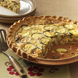 Zucchini Quiche Recipe - This is really good. Here's what I did differently than the recipe: I added diced ham on the mustard before adding the zucchini mixture. I used 3 eggs instead 2. I also didn't have 2 cups of mozz so I used 1/2 cup mozz, 1/2 shredded parm, and 1 cup mild cheddar. Oh, and I shredded the zucchini instead of slicing. ~RB