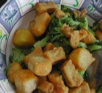 Crispy Pan-Fried Tofu with nutritional yeast, flour, and garlic powder. Tastes exactly like chicken nuggets!