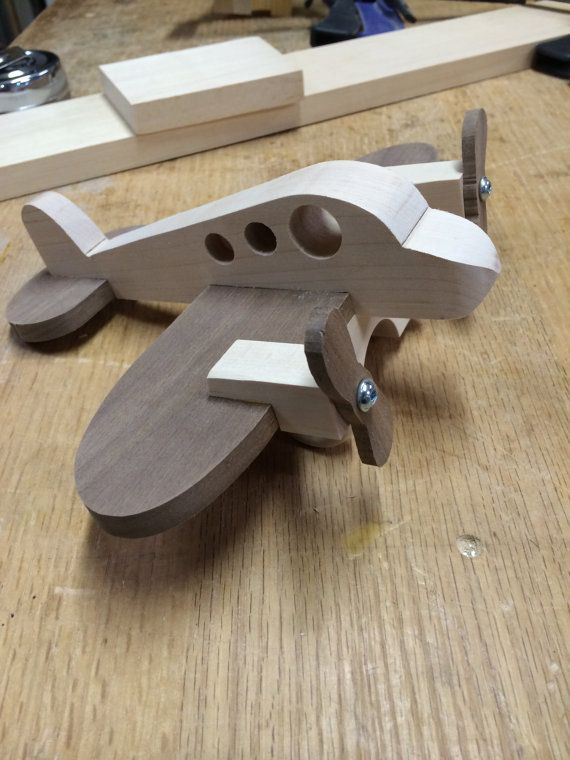 Handcrafted wood toy airplane.  Built with solid walnut and maple woods this plane will soar for a long time. Propellers spin like the real ones. Your little pilot will fly through the house on imaginary flights. Total length is 8.5 and wingspan is 9.5  I usually have these in stock, however in the event I dont usually in 2-3 days from order I can ship to you.  I normally build these as you see in the photo, however the wood types can be reversed for a different look. Just let me know.