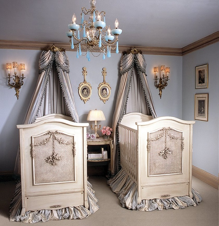 perfect baby room for twins. i am a twin and i guarantee we never had cribs like this!