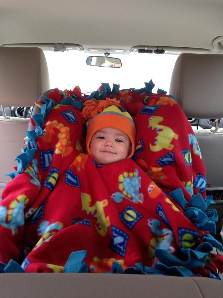 Brilliant, an easy fleece tie blanket poncho; keep your child super warm since they can't safely wear a jacket/sweater in their car seat