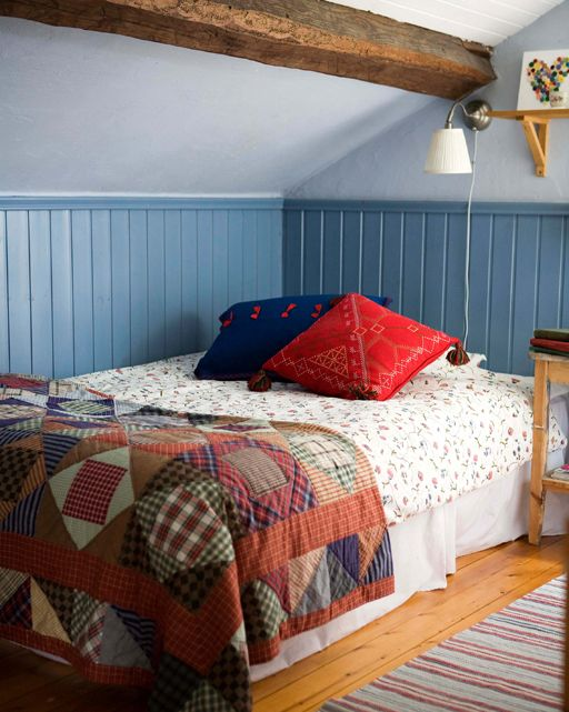 Patchwork quilts give a cosy country look