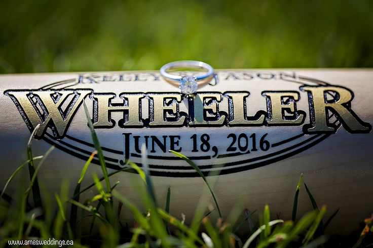 baseball engagement session. Engraved baseball bat with the names and wedding date of the couple.  copyright Ames Photography 2015 www.amesweddings.ca