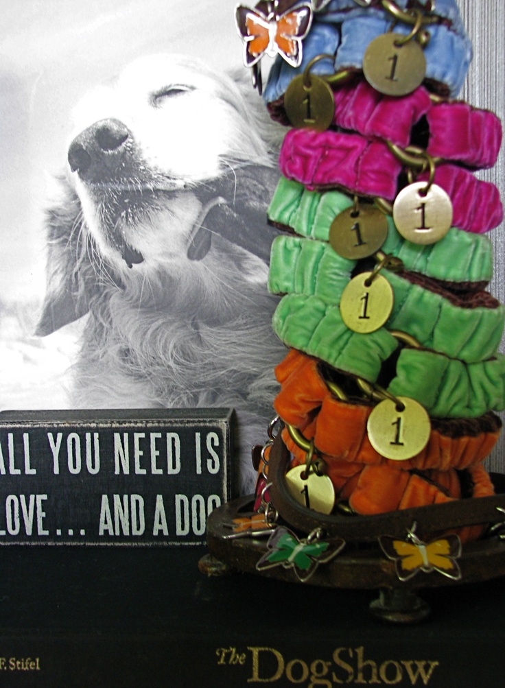 Easy Display of Toy dog velvet collars. Place velvet toy collars on a paper towel roll holder and surround with dogs books for a great visual display