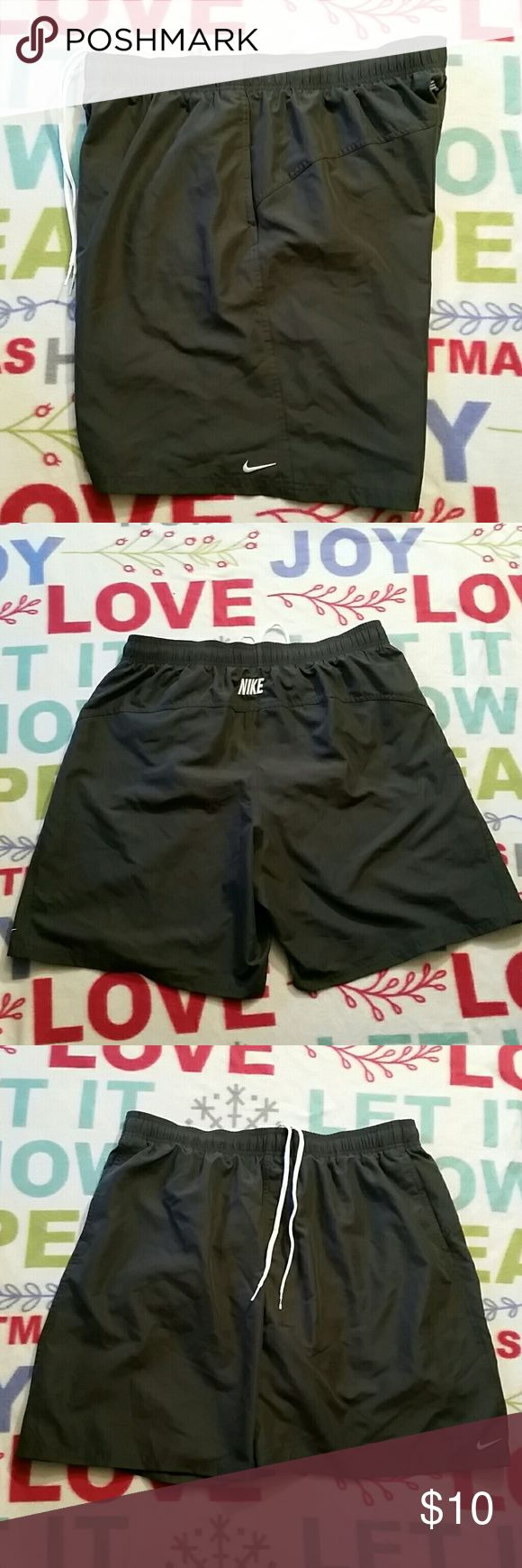 Mens Nike Swim Shorts Gray/white swim shorts with Drawstring..In good condition.Does have pockets. Nike Shorts Athletic