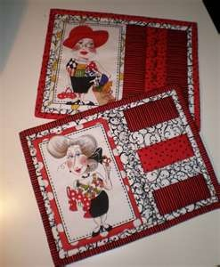 I have several of her panels and now I know what I can do with them.....Mug Rugs!