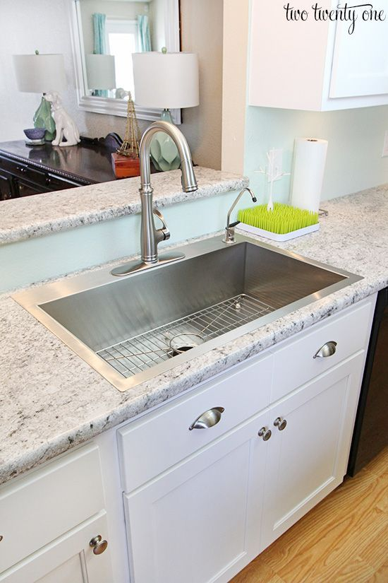 "one large bowl --stainless steel ""drop in"" sink and nice high faucet"