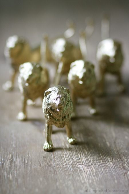 Working on a Narnia birthday party...gold spray painted dollar store lions...priceless.
