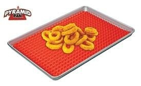 """Pyramid Pan™  Item #: NR2460  Price: $16.98     Get crispier, more evenly cooked foods! Unique silicone cooking mat allows air to circulate under the food, letting fat drip away and preventing foods from sticking or burning.     No frequent turning required!     Non-stick mat is oven safe to 425ºF, dishwasher and microwave safe.     Can be trimmed to fit your favourite pan.  (16""""L x 11-1/2""""W)    Pan NOT Included"""