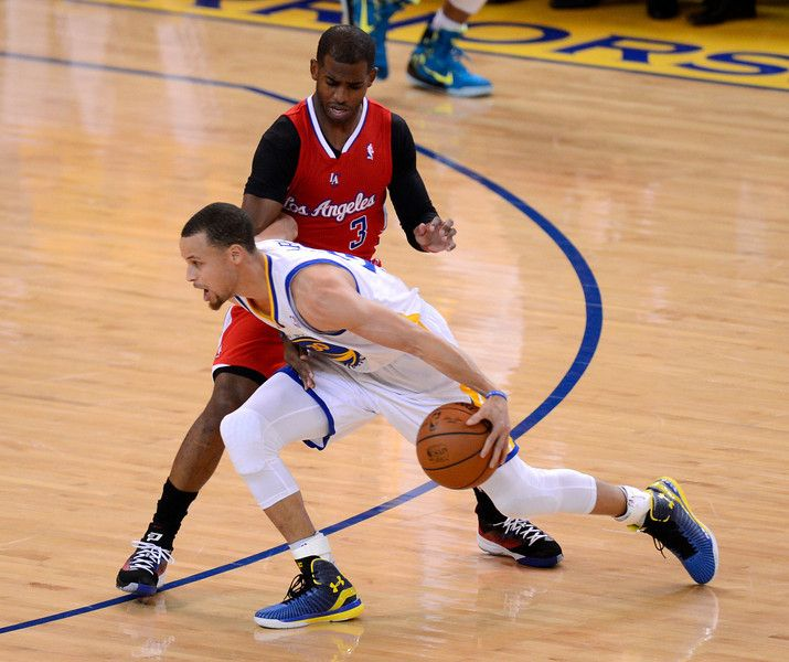 Description of . Golden State Warriors' Stephen Curry (30) dribbles against Los Angeles Clippers' Chris Paul (3) in the first quarter in Game 6 of their Western Conference NBA Playoff game at Oracle Arena in Oakland, Calif. on Thursday, May 1, 2014. (Jose Carlos Fajardo/Bay Area News Group)
