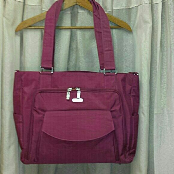 NWT Baggallini Alpha Laptop Special Edition Purse New in original bag,  this was purchased as a gift. 11 inch drop shoulder straps.  52 inch removable/adjustable crossbody strap. front and interior padded technology pockets. interior organizational pockets.  removable coin purse included.  luggage access zipper on back. 15.5 inches wide x 13 inches high x 5 inches deep.  the color is Berry with yellow interior. Baggallini Bags Laptop Bags