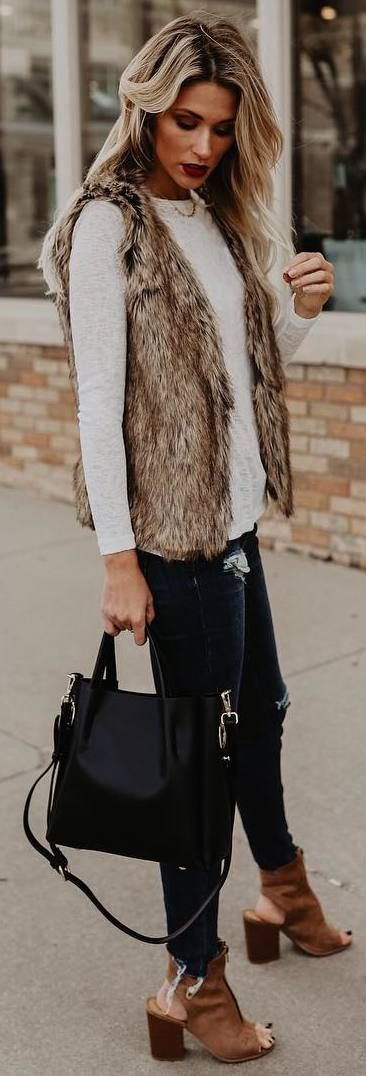 #fall #outfits sleeveless furry coat black ripped jeans