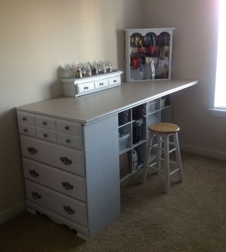 Craft Desk made from an old dresser (sawed the top draw off and use it on top as an organizer) and the supports are made from inexpensive closet maid cubicals .. the top is a $4 door from Lowes clearance that someone returned after drilling holes in