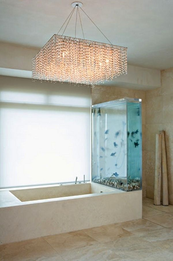 Kanye's bath inclusive of a 250-gallon tank filled with black moor and chocolate Organda goldfish. That's amazing and so is the chandelier!