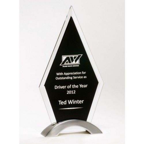 "Our Beveled Black Glass Trophy features a 3/8"" thick glass piece with a black engraving area mounted on a silver arch.  G2432 is 5.5"" x 10"" and includes free personalized engraving."