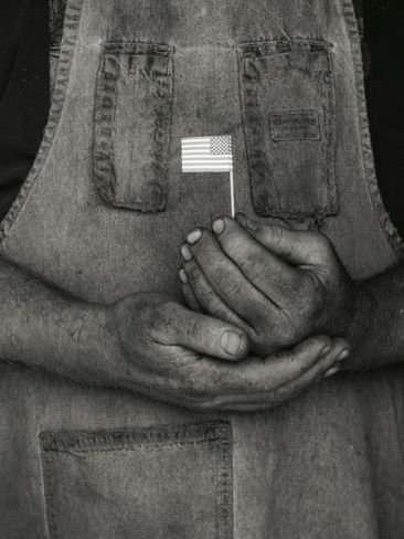 Man Holding Small American Flag Supporting His Country