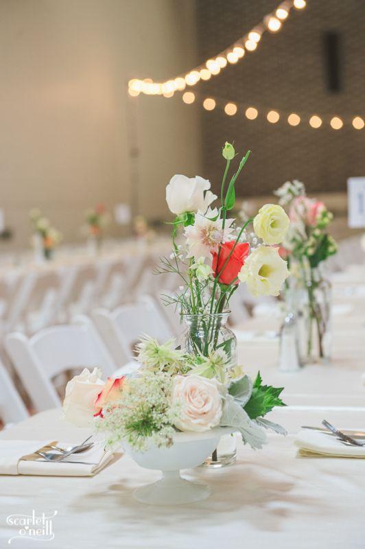 #wedding #DIYwedding #SummerGardenPartyWedding #whitefoldingchairs #milkvases #DIYcentrepieces #stringlights