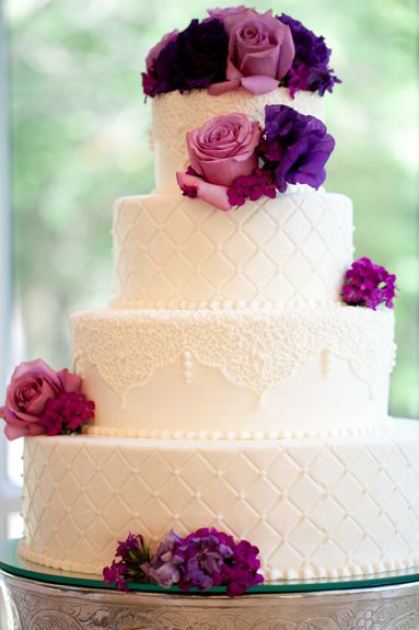 White wedding cake with pink and purple flowers || Photographer: Sarah Ainsworth Photography. Floral Designer: CM Floral Designs. Cake Designer: Virginia's Cakes. featured on Fab You Bliss.