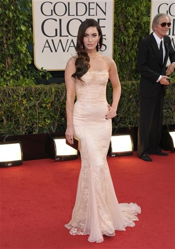 Megan Fox accentuated her Dolce and Gabbana gown with coral Lorraine Schwartz drop earrings at the 2013 Golden Globe awards.