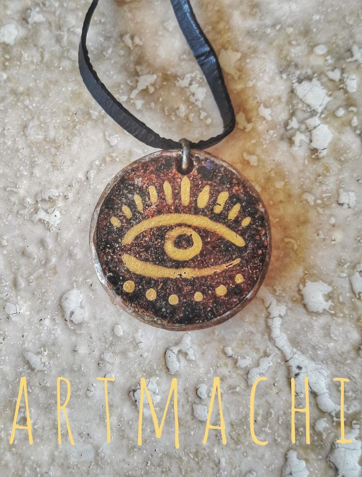 Third eye power Brass handworhed frame, resin, sweet paprika powder, lava stone and golden handpainted third eye.  👐❤Handmade jewel created with natural elements 🌾🍁🌻🌱 A kind of unique ✨Amulet✨ that you can wear everyday to keep always with you the 🌿Power of Nature🌷! Handmade with L❤ve by ✨ARTmachi✨ 👁Come to visit my profile👁 and follow me! You can find me also on Pinterest http://pin.it/ZSOBpDL  Etsy http://etsy.me/2jhO77g Facebook https://www.facebook.com/artmachi23