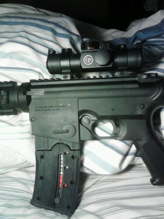My new tactical mossberg with a red dot :)