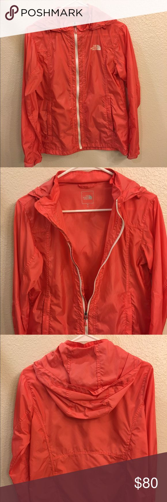 North Face women's pink/coral jacket. Brand new North Face jacket from Korea. They don't have this style in the US. Very lightweight and perfect for every day use. The size says LARGE but it's more like a MEDIUM. Picture looks kind of red but it's more of a pinkish coral color. North Face Jackets & Coats