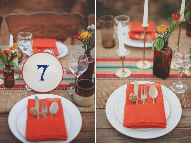 orange tablescape Yes!  A dinner reception for a beautiful southwest wedding is the perfect setting for using the Cricut Southwest cartridge. Everything from table numbers to place cards to directional signs could have that special southwestern flair provided by the images on that cartridge.