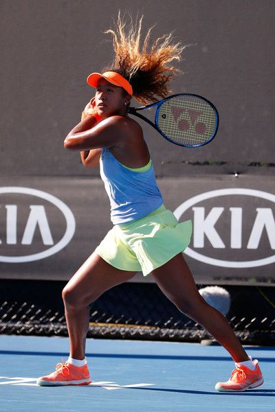 Naomi Osaka Photos - Naomi Osaka of Japan plays a backhand in her second round match against Elena Vesnina of Russia on day four of the 2018 Australian Open at Melbourne Park on January 18, 2018 in Melbourne, Australia. - 2018 Australian Open - Day 4
