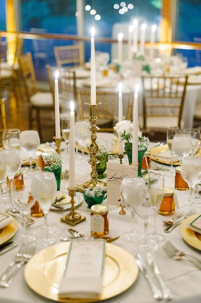 M2 Photography captures the perfect green and gold candlelight reception.