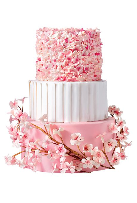 Brides.com: The Most Creative Wedding Cakes of the Year This cherry-blossom-covered cake is as girly—and detail oriented—as the most feminine, princess-like bride. (Those sugar petals took 24 hours to sculpt!)  Pink and white wedding cake with sugar cherry blossoms, $16 per slice (serves 80), Heather Barranco Dreamcakes  See more pink wedding cakes.Photo: Dyad Photography