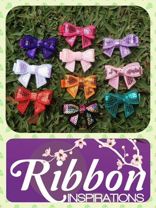 Handmade by Kate from Ribbon Inspirations Sequin bows on a lined alligator clip with non slip grip.