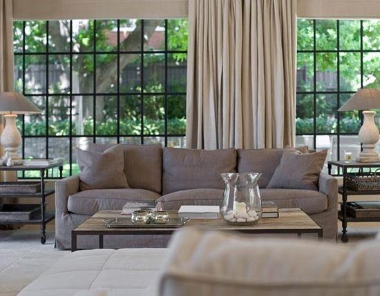 glass windows linen sofa