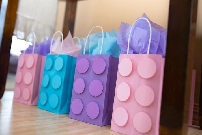 Georgia helped me make these by punching all of the circles.  Favor Sacks from a Girl Themed Lego Party via Kara's Party Ideas | KarasPartyIdeas.com (26)
