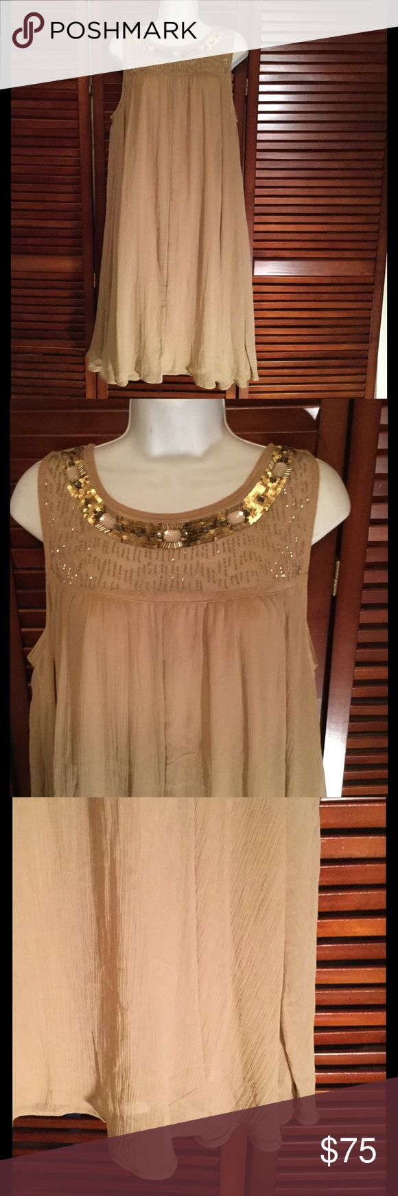 Gold plus size dress with beading and sequins Gold shift dress with beautiful beads and sequins around the neck. This dress is fully lined with a zipper down the back. Never been worn. Lane Bryant Dresses Midi