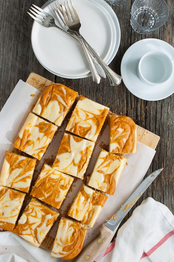 Marbled Pumpkin Cheesecake Bars - swirls of pumpkin and cheesecake with a graham cracker crust make for a perfect fall snackl.   tamingofthespoon.com