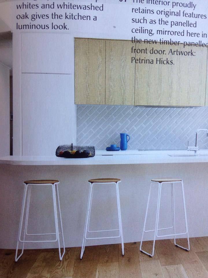 Timber veneer to overhead cupboards only