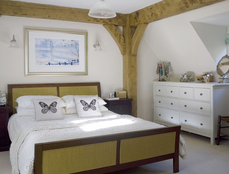 modern country bedroom add some cedar beams to wall where headboard is located instead of a headboard