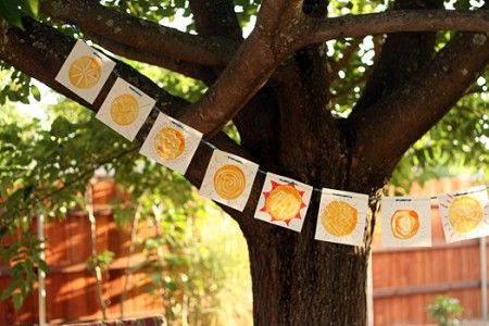 Ideas for crafts to celebrate Summer Solstice.  Pictured: sunshine monoprints banner for summer