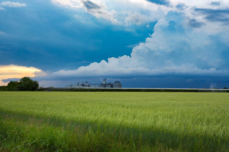 Clouds Factory - Farm near Codroipo in Friuli Venezia Giulia region (Italy) with storm and beautiful clouds above.
