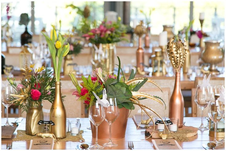 Wedding inspiration, vibrant pink and gold decor. Natural wood elements. Tulips, wild flowers and succulents.
