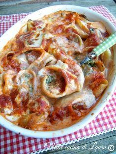 conchiglioni stuffed with ricotta and spinach au gratin in the oven - in the kitchen of laura