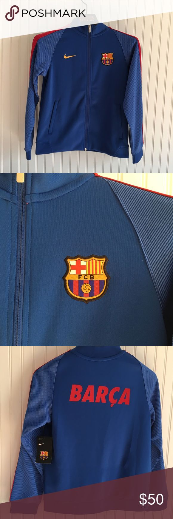 """New NIKE FC BARCELONA YOUTH JACKET Royal Blue Nike Barcelona youth warm up jacket in a size Large. This is new with tags. With Barca on the back. Elastic waistband and zippered side pockets. One small stain on the back on the upper right( see pic), No rips or holes,   APPROXIMATE MEASUREMENTS FLAT ACROSS:  Chest:18.5"""" Waist:18"""" Length: 23.5"""" Nike Jackets & Coats"""